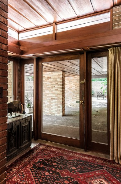 A grand glass door serves as the entrance to the home.