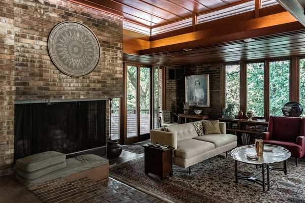 The elegant space is anchored by a brick, wood-burning fireplace.