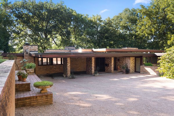The L-shaped home is a classic example of Frank Lloyd Wright's Usonian style.