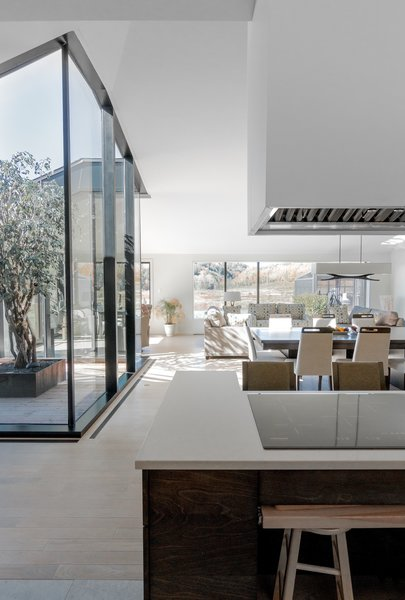 High ceilings and white interiors give the home a bright and airy feel.