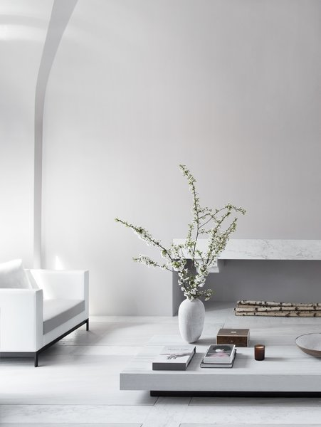 "The bespoke fireplace is almost 10 feet long and was carved from a single giant piece of natural Carrara marble. The design ""gives the feeling of floating weightless in the air."""