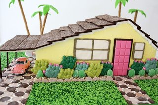 We love this Palm Springs-style gingerbread creation, complete with native drought-resistantplants, a carport,and even a kidney-shaped pool in the rear. Unfortunately, the vintage pink Bug is not edible.