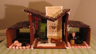 This 1950s-inspired gingerbread house originally found on Flickr is complete with period-appropriate decor that includes a black Eames lounge chair, a Noguchi table, a coconut shag rug, a wafer cookie brick inlay chimney, and a Nelson wall clock to complete the retro look.