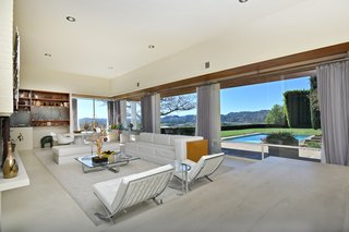 The living room overlooks the swimming pool.