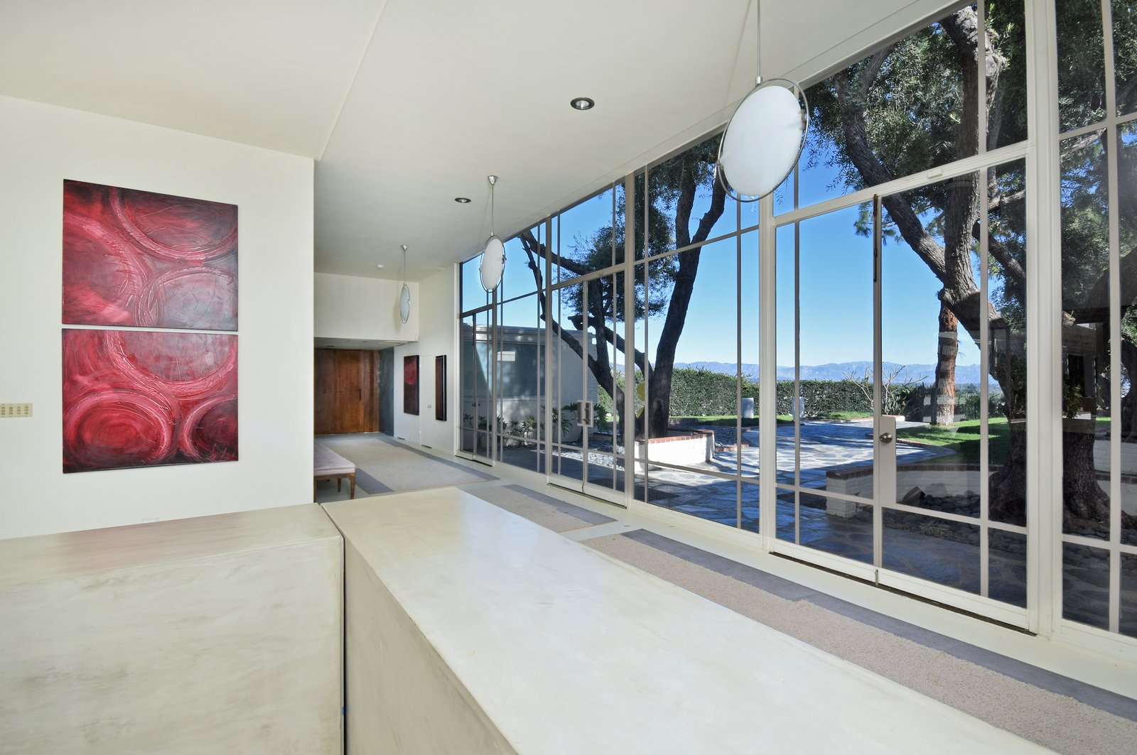 Byrdview Frank Sinatra estate entryway with floor-to-ceiling glass