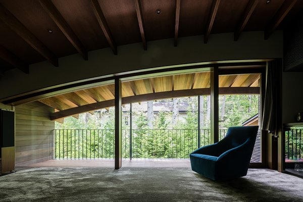 The arched form of the roofline provides a cozy, second-floor interior space.