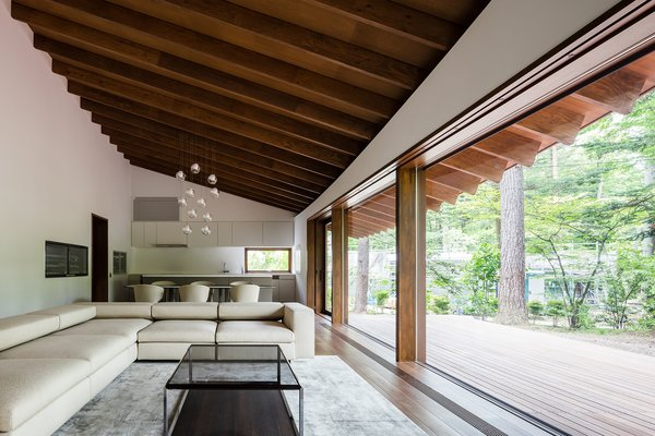 Floor-to-ceiling glazing makes for a bright and airy living space and overlooks the exterior terrace.