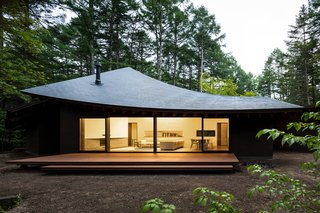 Located in Karuizawa, a popular summer resort town in Japan's Nagano Prefecture, Four Leaves is a weekend getaway designed to accommodate the homeowner and their guests in a lush, sylvan setting. Designed by Kentaro Ishida Architects Studio (KIAS), the highlight of the stunning, 2,400-square-foot house is its sloping, angular roof sections that are delicately assembled to resemble fallen leaves.