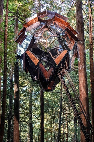 Designed and built by Oakland–based O2 Treehouse, the Pinecone is a five-and-a-half-ton geodesic home that can be installed in the forest or in your own backyard. The treehouse, accessed via a wood ladder and a trap door, is constructed from steel, wood, and glass that integrates into the forest canopy. Inside, 64 diamond-shaped windows provide 360-degree views of the surrounding forest or landscape. Even the floors are composed of transparent panels—enhancing the sensation of floating above the earth.