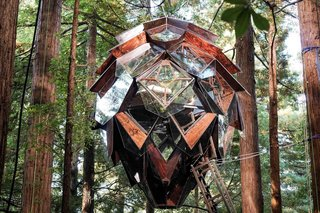 Suspended in the forest, the Pinecone tree house is a sight to behold.