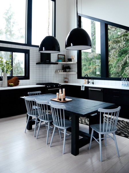 """The windows feature high-gloss interior paint trim. """"In Holland, they use high-gloss white; we used black,"""" says Sara."""