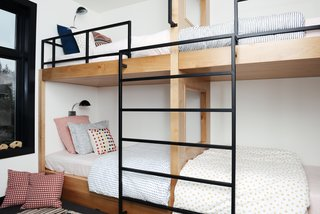 The children's bunk beds are custom made and the bedding is from Schoolhouse. The black Radar Sconces are from Schoolhouse.
