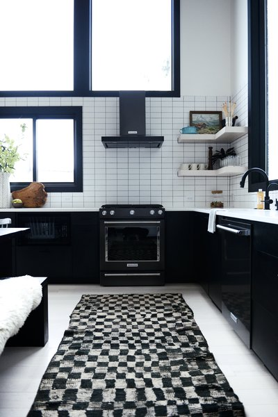 """In my Alpine Noir project, we used laminate kitchen cabinets because of the ease of maintenance and cost savings,"" explains interior designer Casey Keasler of Casework. The vintage Moroccan checkerboard runner is from Kat + Maouche."