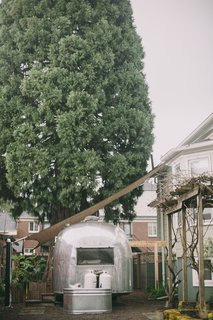 The Airstream is parked under a tall sequoia in the couple's Portland backyard.