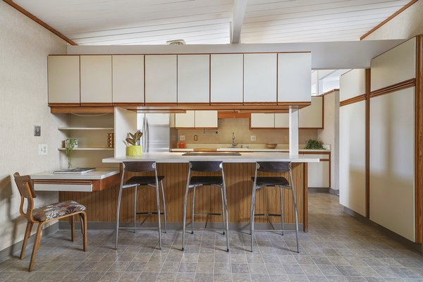 The open kitchen features ample storage and a breakfast bar.