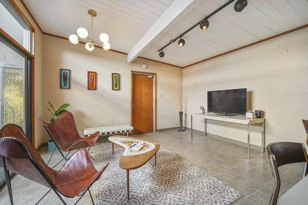 The Sitting Room Provides Another Space To Lounge And Entertain.