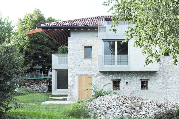 The home reinterprets the city's building code, which governs the use of stone in the seismically active region.