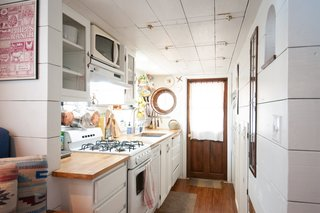 """Kell found appliances which perfectly fit her small space: an 18"""" dishwasher, a 20"""" stove/oven, and a refrigerator that's about a foot smaller than a full-sized one."""
