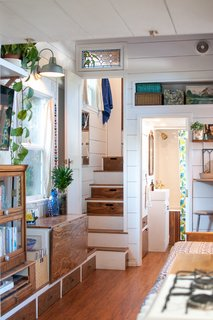 Kell didn't want to have to climb ladders to access the bedrooms, so she built narrow stairways with doors to provide privacy. Transom windows above the doors open for air circulation when the thru-wall fans are on.