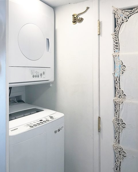 She was even able to squeeze in a compact stacked washer and a vented dryer.