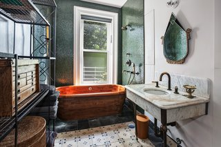 The master bath features a wooden bathtub imported from Scotland.