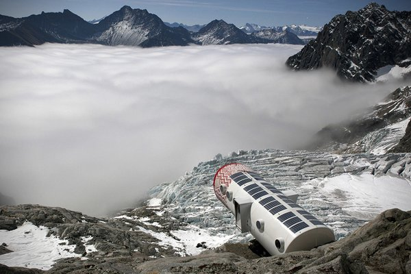 Italian prefab company LEAPfactory built this alpine shelter off-site and had it flown in via helicopter. Cantilevered off the edge of a mountain, the structure features a living room, a dine-in kitchen, bunk beds, storage closets, and an integrated computer to keep mountaineers and climbers up-to-date on the weather conditions.