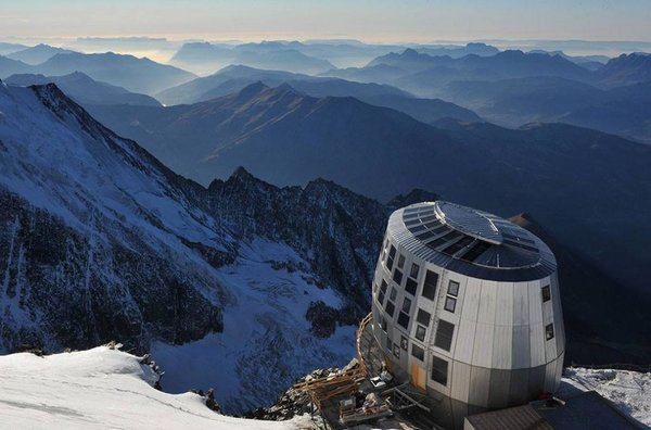 The Gouter Refuge is located at 12,582 feet in elevation (about 3,280 feet below the summit of Mont Blanc) along the Gouter route. The four-story, rounded structure juts out over a 4,921-foot drop, and it's the last stop before the final climb to the summit of Mont Blanc. Commissioned by the French Alpine Club and designed by Swiss architect Hervé Dessimoz, the wooden structure is clad in stainless steel and took five years to design and three years to build.