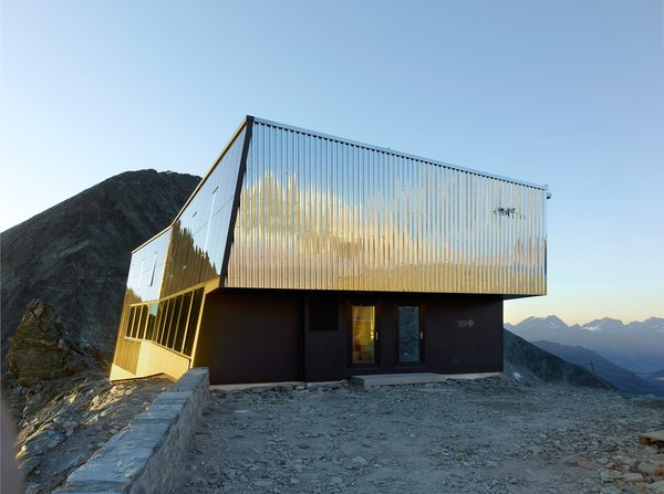 Designed by Savioz Fabrizzi Architects, the Tracuit Hut is a mountain shelter run by the Swiss Alpine Club. The shelter is located above Zinal in the canton of Valais, at an elevation of 10,780 feet. It's named after the Tracuit Pass in which it is located.