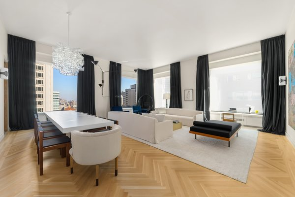 The corner living/dining room offers both north and east exposures with Central Park and city views.