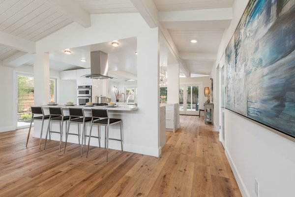 The centerpiece of the open plan is an updated kitchen with a breakfast bar.