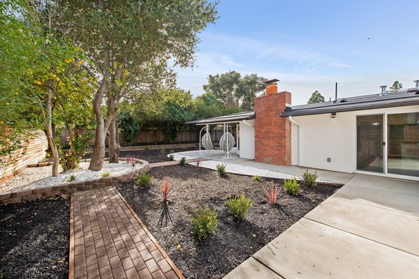 The 8,250-square-foot lot (per tax records) includes landscaped back and side yards.