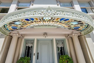 The home's entrance features Tiffany stained glass windows.
