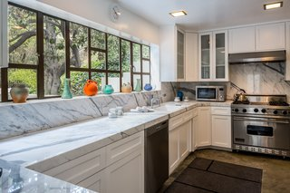 The updated kitchen features high-end appliances.