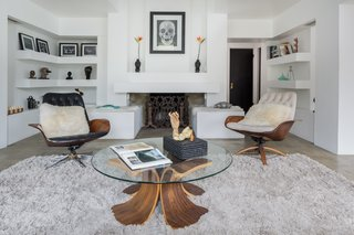 The updated living room is in keeping with the architect's original vision.