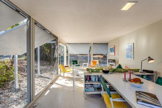 The petite, open-plan guesthouse is divided into public and private spaces.