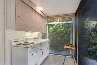 The cozy kitchen maintains a connection to the outdoors.