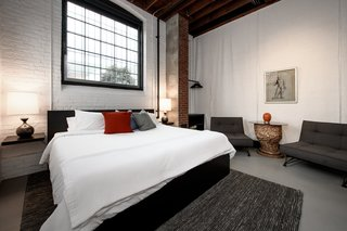 Factory windows and high ceilings give the space a cool industrial feel.