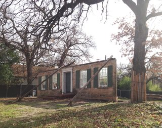 Before: following the demolition of the original home, only the front facade remained.