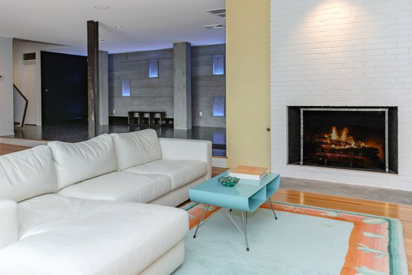 In addition to a wet bar and laundry room, the downstairs has a large, open space—once known as the children's living room—with a wood-burning fireplace and direct access to the grounds and pool.
