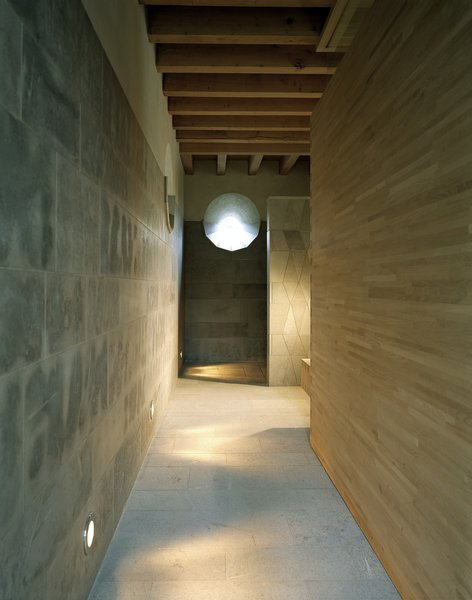 The sauna area is constructed from natural materials like stone and wood.