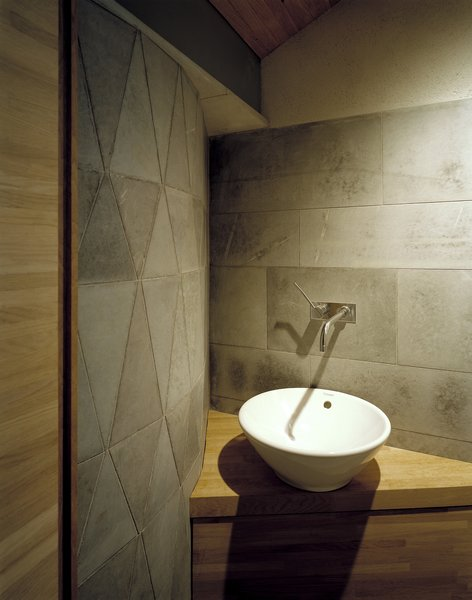 Geometric stonework accents the area around the sink.