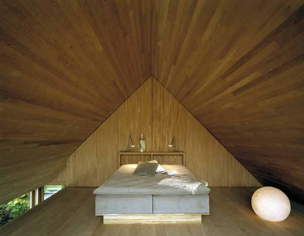A wood-paneled sleeping alcove lies upstairs.