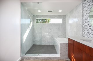 This bathroom features a glass-enclosed shower and bathtub.