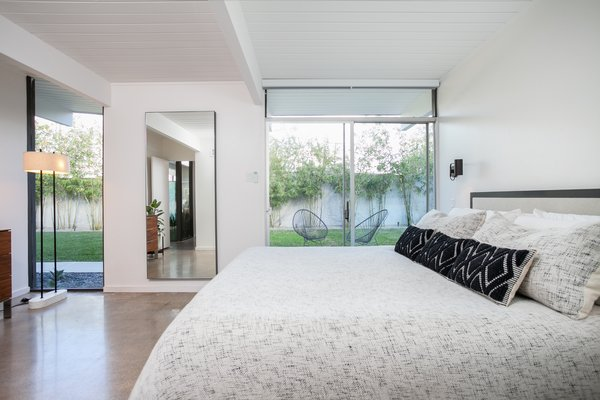 The master bedroom features sliding glass doors leading outdoors.