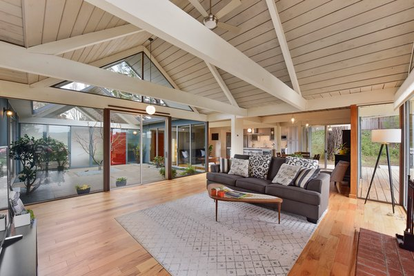 The open-plan living area features soaring, vaulted ceilings thanks to the double A-frame design.
