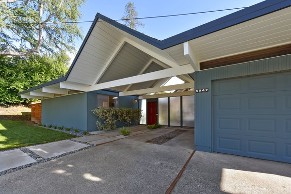The home features a one-car garage and a covered carport.
