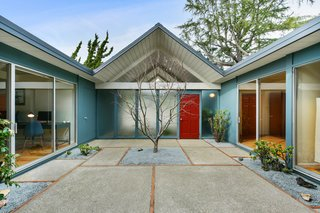 Eichler's double A-frame models are rarely available and are highly coveted due to their design and extra square footage. Measuring in at 2,000 square feet—not including the spacious atrium—this model boasts five bedrooms and two full baths. The home also features soaring tongue-and-groove ceilings, expansive glazing, and globe pendant lights throughout.