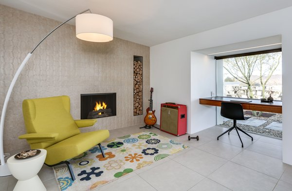 The cozy wood-burning fireplace warms the home when the desert nights turn cold. A rectangular cutout provides a built-in spot to store wood.