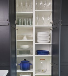 Floor-to-ceiling cabinets add ample storage space and also help hide any mess.