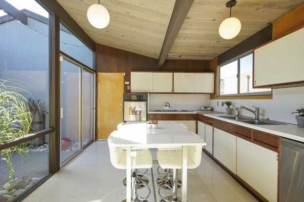 The Galley Kitchen Has Original Cabinetry And Countertops, All In Excellent  Condition According To The